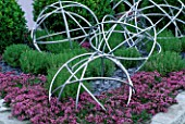 PINK THYME WITH METAL GLOBES. TATTON PARK 2002  DESIGNER: MYFANWY JONES
