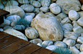DETAIL OF WHITE BOULDERS  DECKING AND FESTUCA GLAUCA: DESIGN BY ALISON WEAR ASSOCIATES