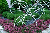 TATTON PARK 2002/ DESIGNER: MYFANWY JONES: PINK THYME WITH METAL GLOBES