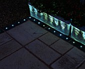 PATIO AND CONTAINER WITH LIGHTING. LIGHTING BY VERSATILE ILLUMINATED PAVING LTD