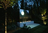 SANCTUARY GARDEN SPONSORED BY MERRILL LYNCH AT THE CHELSEA FLOWER SHOW 2002: DESIGNED BY STEPHEN WOODHAMS: WATER FEATURE LIT UP AT NIGHT