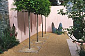 TWO ROUNDED METAL SEATS IN FRONT OF PINK WALLS IN LLADROS SENSUALITY GARDEN. ROW OF CLIPPED CARPINUS TREES. IN FOREGROUND.  CHELSEA 2003. DESIGNER FIONA LAWRENSON