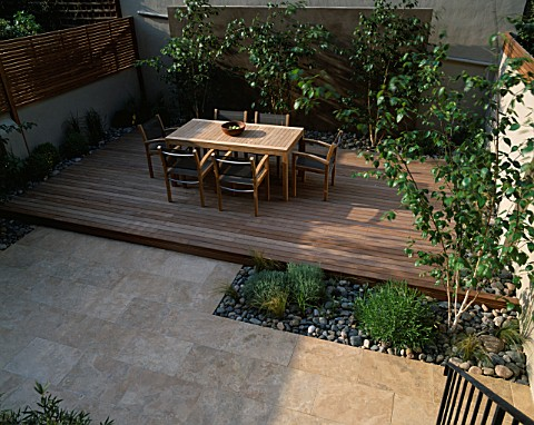 ROOF_GARDEN_LIMESTONE_PAVING__BEECH_PEBBLES__TEAK_TABLE_AND_CHAIRS__ITALIAN_POLISHED_PLASTER_WALL__A