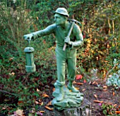A STATUE OF A MINER DECORATES THE TERRACE AT PYRFORD COURT GARDEN  SURREY