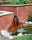 PETERSFIELD GARDEN WATER FEATURE: RENDERED CONCRETE WALL  RILL AND WATER FEATURE. DESIGNER: MARK LAURENCE
