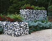 WESTONBIRT INTERNATIONAL FESTIVAL OF GARDENS  2003: SCREEN4 BY PRP LANDSCAPE. FLINT BLOCK WALLING