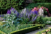 THE PRIORY  BEECH HILL  BERKSHIRE: AMERICAN PILLAR ROSE TRAINED OVER TRELLIS  DELPHINIUMS AND CARDOON IN TRIANGULAR PICKING BED