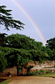 THE PRIORY  BEECH HILL  BERKSHIRE: OLD CEDAR TREE WITH WROUGHT IRON GATE INTO THE WALLED GARDEN AND RAINBOW