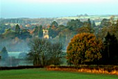 ARLEY ARBORETUM  WORCESTERSHIRE: THE CHURCH AND ARBORETUM AT DAWN IN AUTUMN