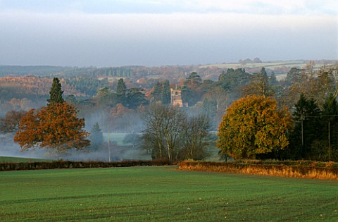 ARLEY_ARBORETUM__WORCESTERSHIRE_THE_CHURCH_AND_ARBORETUM_AT_DAWN_IN_AUTUMN