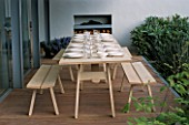 CHELSEA FLOWER SHOW 2004: LAURENT PERRIER/HARPERS & QUEEN GARDEN BY TERENCE CONRAN AND NICOLA LESBIREL. DINING DECK BESIDE THE PAVILION KITCHEN WITH WOODEN TABLE AND CHAIRS