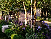CHELSEA FLOWER SHOW 2004: THE KNIGHTSBRIDGE URBAN RENAISSANCE GARDEN. WHITE STEMMED BIRCH TREES  CANAL AND GRANITE TUBE WATER FEATURE. DESIGN: PHIL JAFFA/PATRICK COLLINS