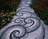 CHELSEA FLOWER SHOW 2004: LIFE GARDEN DESIGNED BY JANE HUDSON AND ERIK DE MAEIJER: DETAIL OF PEBBLE MOSAIC PATH BY MAGGY HOWARTH