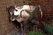 DOWNDERRY NURSERY  KENT: METAL COW BY COLIN COMRIE