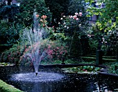 AMSTERDAM: PRIVATE GARDEN WITH FOUNTAIN  POOL AND ROSES