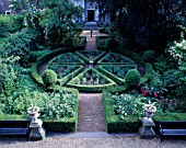 AMSTERDAM: PRIVATE GARDEN - VIEW ONTO FORMAL GADEN WITH CLIPPED BOX  URNS AND SUNDIAL
