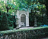AMSTERDAM: PRIVATE GARDEN - FORMAL GARDEN WITH STATUES AND WHITE TRELLIS ARBOUR