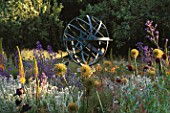 ANGEL COLLINS GARDEN: SUNDIAL BY DAVID HARBER SURROUNDED BY ALLIUM GLOBEMASTER  POPPIES AND ANCHUSA AZUREA LODDON ROYALIST
