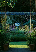 ANGEL COLLINS GARDEN: SUNDIAL BY DAVID HARBER IN BED WITH IRISES  ANCHUSA AZUREA LODDON ROYALIST  ALLIUMS AND CARDOON