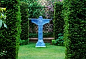 THE ABBEY HOUSE  WILTSHIRE: YEW HEDGES WITH VIEW TO BRONZE RESIN SCULPTURE OF ST FRANCIS OF ASSISI BY BILL HARLING
