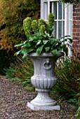 URN IN FRONT OF HOUSE PLANTED WITH EUCOMIS. PARSONAGE  OMBERSLEY  WORCESTERSHIRE