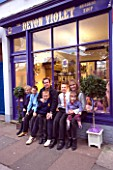 JOHN AND MELANIE BRAY WITH THEIR FIVE CHILDREN IN FRONT OF THEIR DEVON VIOLET NURSERY SHOP