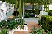 DECKING PATH  AND BOX YEW HEDGING IN HIS LATE HIGHNESS SHAIKH ZAYED BIN SULTAN AL-NAYHANS GARDEN BY CHRISTOPHER BRADLEY-HOLE. CHELSEA 2005