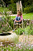 CLARE MATTHEWS SITS ON THE THRONE IN HER GRAVEL GARDEN IN DEVON