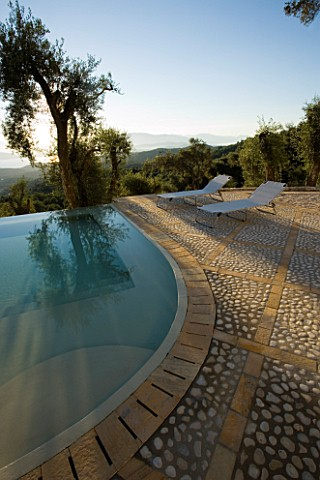 VIEW_OF_THE_ALBANIAN_MOUNTAINS_WITH__OLIVE_TREES_AND_INFINITY_SWIMMING_POOL_IN_THE_FOREGROUND_GINA_P
