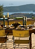 GINA PRICES GARDEN  CORFU: VIEW FROM THE TERRACE ACROSS THE TABLE TO THE IONIAN SEA