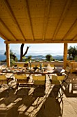 GINA PRICES GARDEN  CORFU: VIEW FROM THE TERRACE ACROSS THE TABLE TO THE IONIAN SEA AND ALBANIAN MOUNTAINS