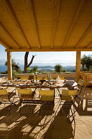 GINA_PRICES_GARDEN__CORFU_VIEW_FROM_THE_TERRACE_ACROSS_THE_TABLE_TO_THE_IONIAN_SEA_AND_ALBANIAN_MOUN