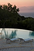 GINA PRICES GARDEN  CORFU: VIEW ACROSS THE INFINITY POOL TO THE IONIAN SEA AND ALBANIAN MOUNTAINS