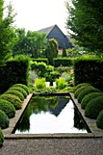 WOLLERTON OLD HALL GARDEN  SHROPSHIRE: THE RILL WITH BOX BALLS AND BOX BALLS AND YEW HEDGING