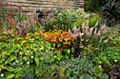 MAYROYD MILL HOUSE  YORKSHIRE. DESIGNERS RICHARD EASTON AND STEVE MACKAY. BORDER WITH HELENIUM SAHINS EARLY FLOWERER   POLYGONATUM AND EUPATORIUM