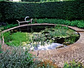 WINGWELL NURSERY  RUTLAND: CIRCULAR POOL (POND) WITH STONE SEAT AND WATER SCULPTURE NEW MOON BY GEORGE CUTTS