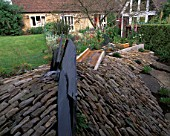 WINGWELL NURSERY  RUTLAND: SLATE WATER SPOUT AND RILL LEADING OFF TOWARDS THE HOUSE. WATER FEATURE