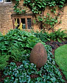 WINGWELL NURSERY  RUTLAND: EGG CERAMIC SCULPTURE BY ROSE DEJARDIN SURROUNDED BY RODGERSIA