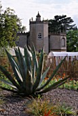 PAN GLOBAL PLANTS  GLOUCESTERSHIRE: VIEW OF FRAMPTON COURT ORANGERY FROM THE WALLED GARDEN WITH AGAVE AMERICANA IN THE FOREGROUND