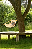 DESIGNER CLARE MATTHEWS: HANGING SEAT MADE FROM DOWEL AND CANVAS HANGS OFF A TREE