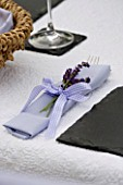 DESIGNER CLARE MATTHEWS: PALE BLUE NAPKIN TIED WITH A GINGHAM BOW AND LAVENDER