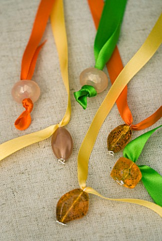 DESIGNER_CLARE_MATTHEWS_HANGING_SCREEN_PROJECT_COLOURED_RIBBON_TIED_TO_BEADS