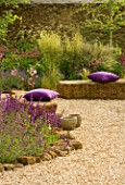 RICKYARD BARN  NORTHAMPTONSHIRE: GRAVEL GARDEN WITH ROCKS  PURPLE CUSHIONS  SALVIA SMOULDERING TORCHES  DESCHAMPSIA GOLDSCHLEIER
