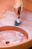 DESIGNER: CLARE MATTHEWS - BUBBLING BOWL WATER FEATURE PROJECT: PAINTING FILLER ONTO TERRACOTTA POT