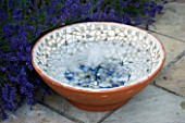DESIGNER: CLARE MATTHEWS - BUBBLING BOWL PROJECT: TERRACOTTA CONTAINER WATER FEATURE ON PATIO BESIDE LAVENDER