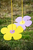 DESIGNER: CLARE MATTHEWS - FLOWERY BUTTON SWINGS PROJECT: BUTTON FLOWER SWINGS HANGING FROM A TREE