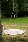 DESIGNER: CLARE MATTHEWS - SWINGING COCOON PROJECT: ROPE AND PLYWOOD COCOON FRAME HANGING FROM TREE