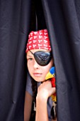 DESIGNER: CLARE MATTHEWS - CHILDRENS PARTY : GIRL PIRATE IN BLACK PIRATE TENT