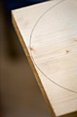 DESIGNER: CLARE MATTHEWS: BENCH AND TABLE PROJECT - CURVE MARKED OUT ON WOOD WITH PLATE
