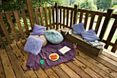 DESIGNER CLARE MATTHEWS: TREE HOUSE PROJECT - CHILDRENS PLAY AREA WITH CUSHIONS  WOODEN SEAT AND BLANKETS